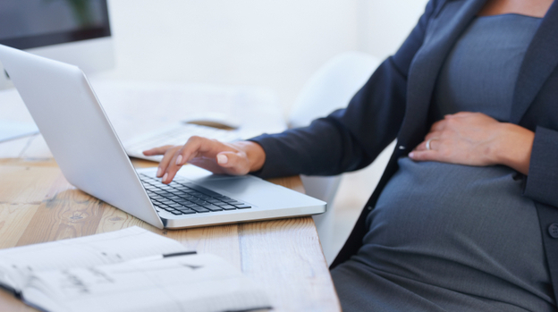While many women continue to work with little change in their duties while pregnant, others find that pregnancy can be a career liability. (iStockphoto)