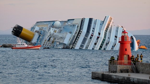 The Costa Concordia ran aground off the Italian coast in 2012, killing 32 people. Its captain was accused of manslaughter and abandoning the 4,200 passengers and crew on the night of the wreck. (AFP/Getty Images)