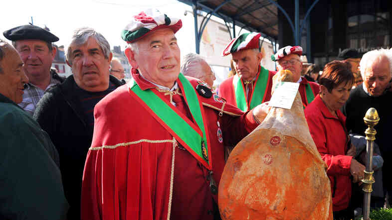 A member of the Bayonne ham authority, La Confrerie du Jambon de Bayonne, with a ham on the first day of the 2014 Bayonne ham fair in southern France.