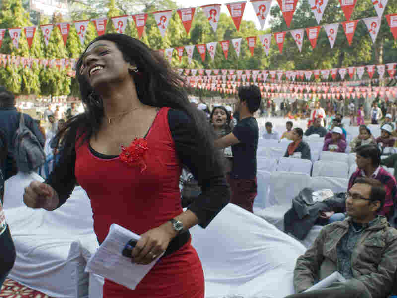 "Aher dances during an event observing World AIDS Day in New Delhi on Dec. 2, 2012. Of the recent legal ruling, recognizing transgender Indians as a third gender, she says: ""We have put a foot inside a door, which is a door of hope, and we will open it — very, very soon."""