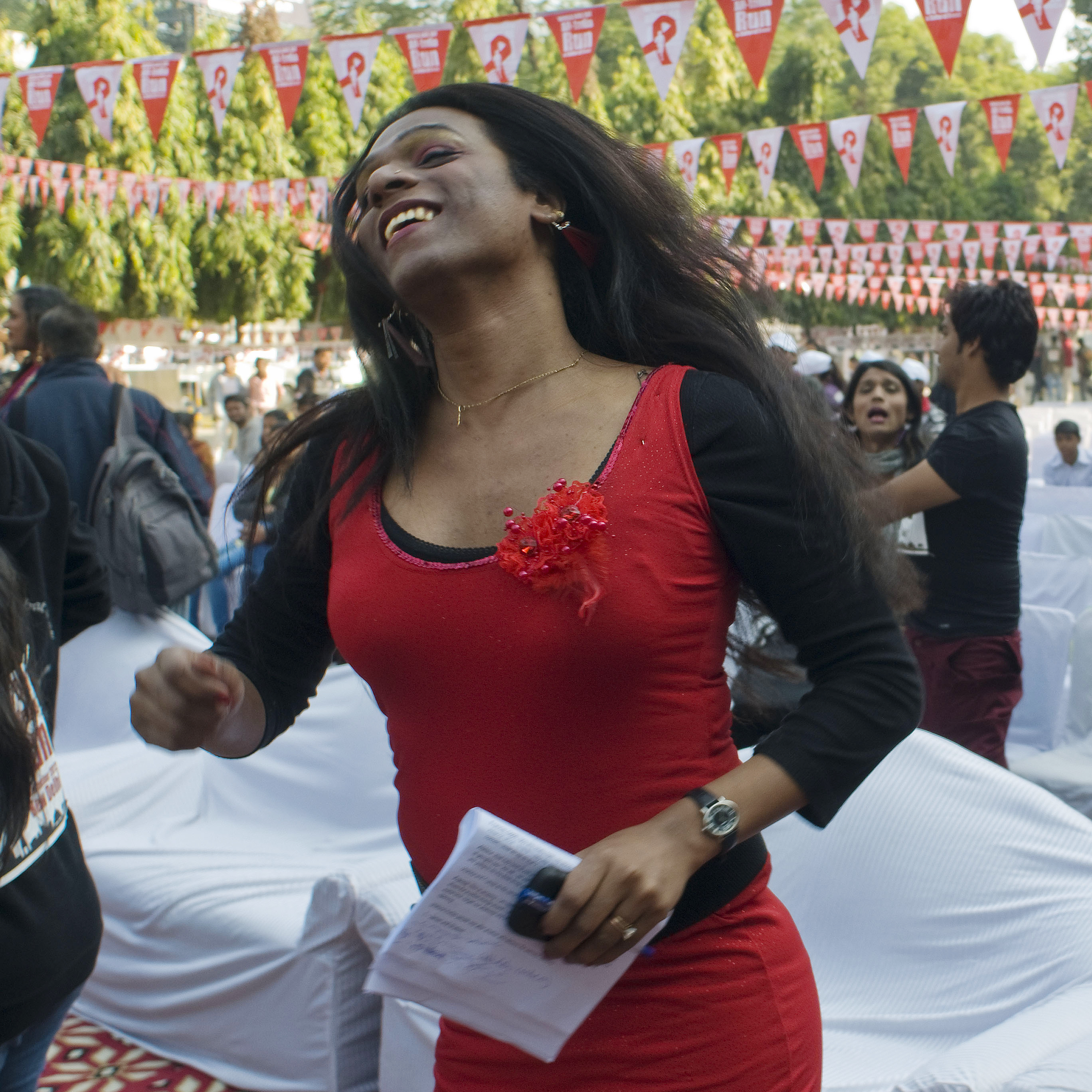 "Aher dances during an event observing World AIDS Day in New Delhi on Dec. 2, 2012. Of the recent legal ruling, recognizing transgender Indians as a third gender, she says: ""We have put a foot inside a door, which is a door of hope, and we will open it -- very, very soon."""