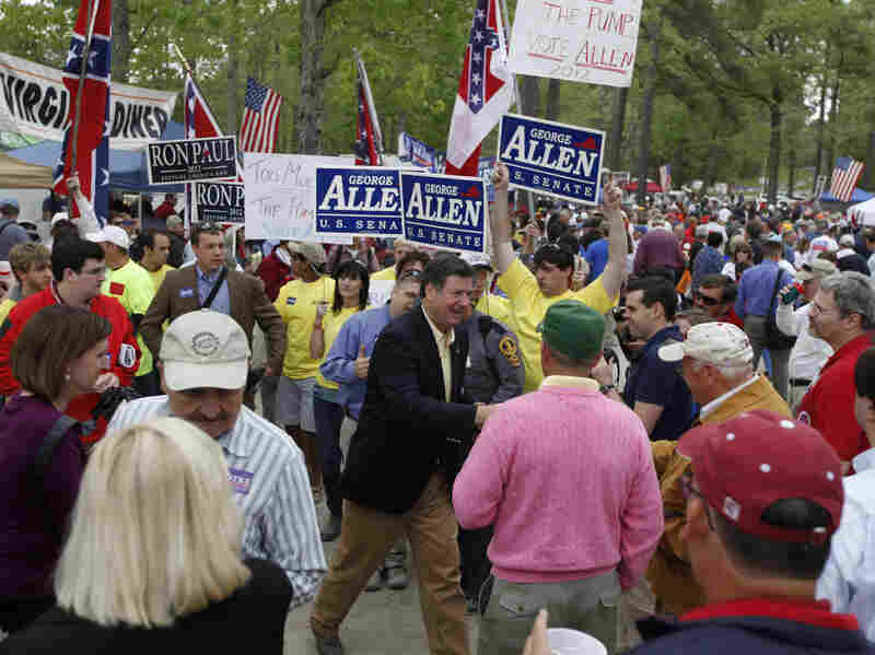 Former Sen. George Allen (center) greets attendees at the 64th annual Wakefield Shad Planking in Wakefield, Va., in April 2012. This year's Shad Planking featured Democratic Sen. Mark Warner as the speaker.