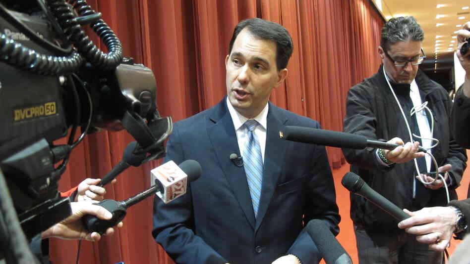 GOP Gov. Scott Walker answers questions from reporters on April 16 in Madison, Wis.