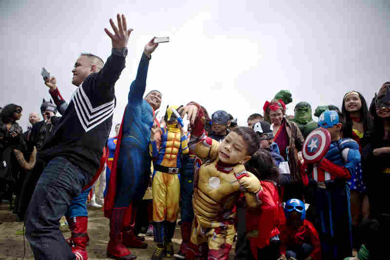 Hundreds of people arrive on the National Mall Friday to try to set a world record for the largest group dressed as comic book characters gathered in one location. The event was organized by Awesome Con 2014, a comic book convention that will take place in Washington, D.C., this weekend.