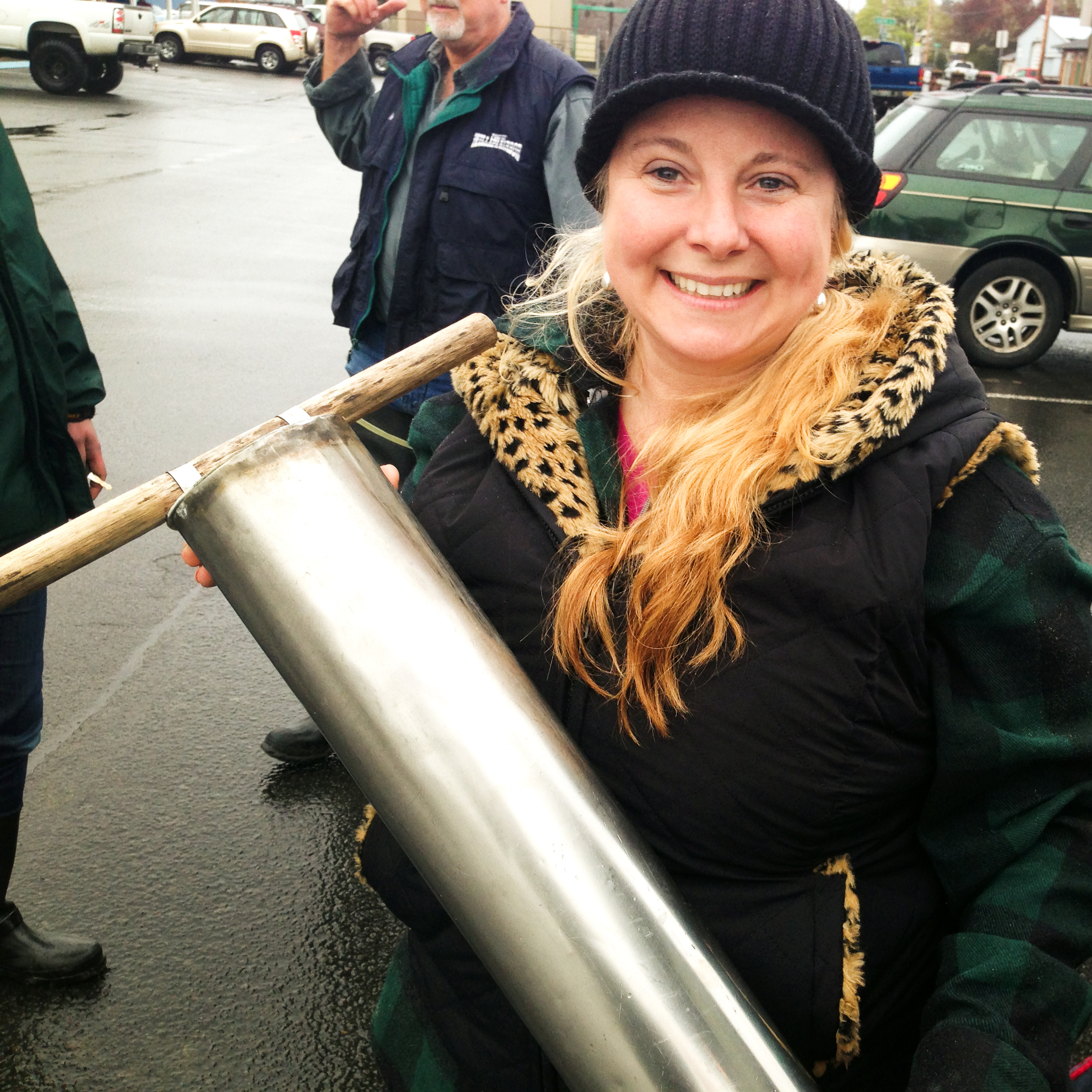 Andi Day shows off the clam gun that her grandfather made for her grandmother in the 1970s. The welded stainless steel is for speed when cutting into the sand; the wooden handles are for comfort.