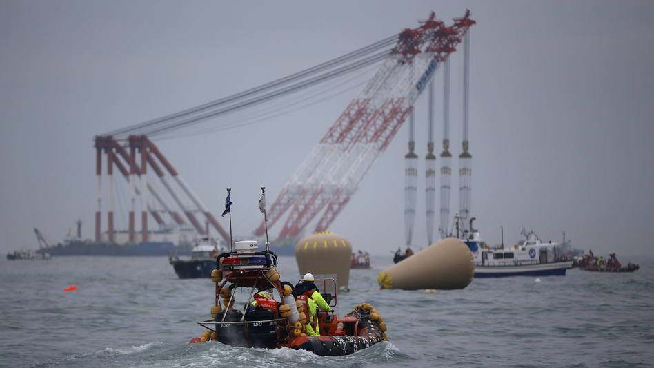 Cranes, ships and other rescue equipment are on the scene off the southern coast of South Korea, where a ferry capsized Wednesday. About 270 people, most of them high school students, remain missing. (Reuters/Landov)