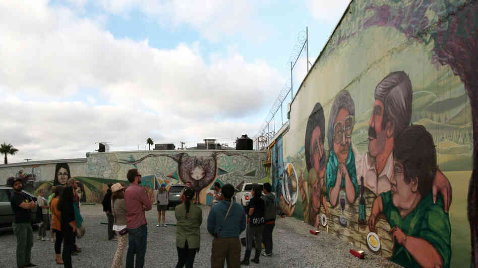 Turista Libre's street art tour takes people around Tijuana to check out the city's murals. Mexican muralists Glow and El Norteno accompanied the g