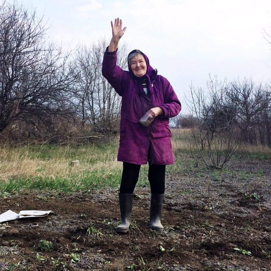 "In the rundown Ukrainian town of Perevalsk, near the Russian border, 80-year-old Lida Vasilivna has just planted a garden. ""Business just went belly up,"" she says about her town's hard times -- after asking, ""Are you gonna put this granny on TV?"""