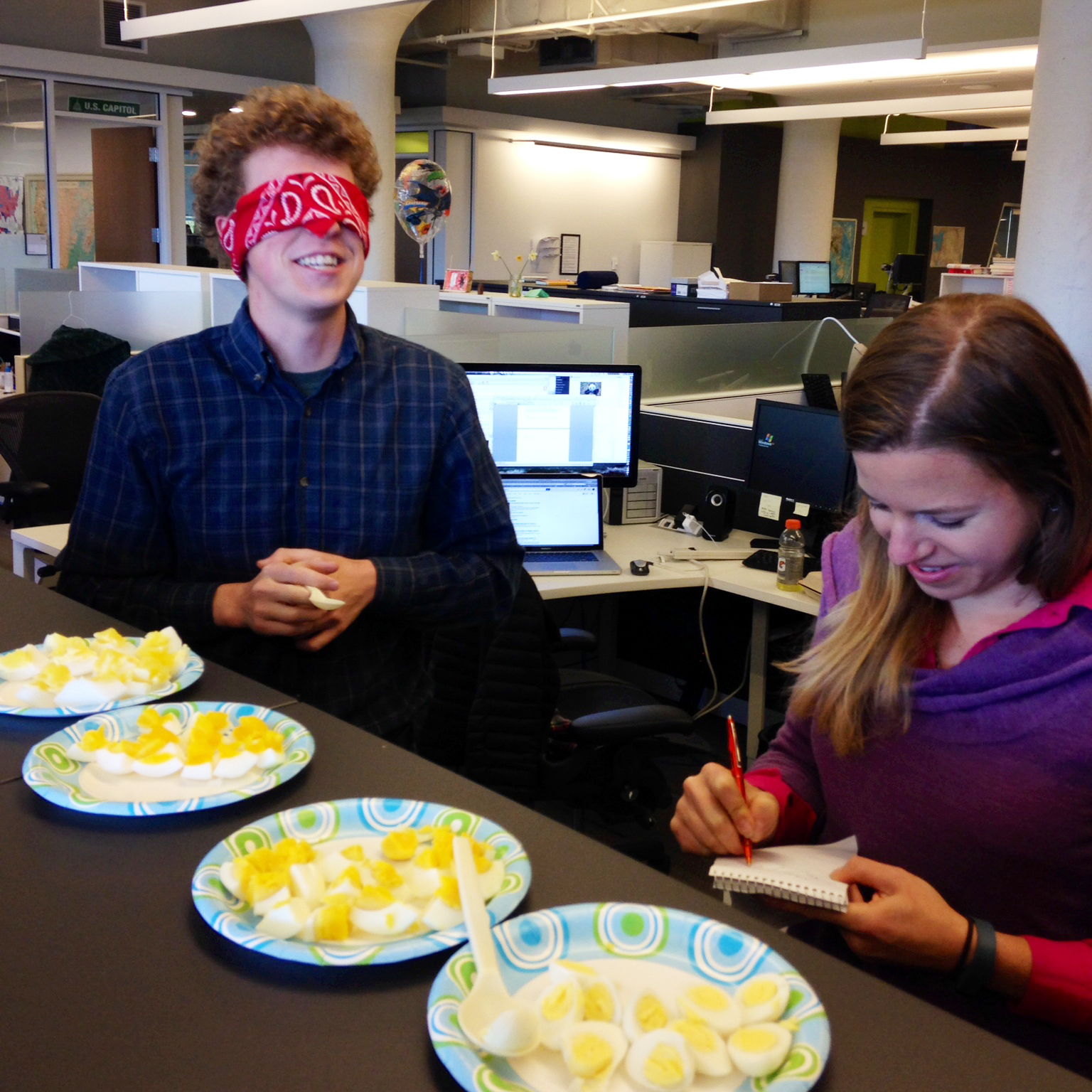 NPR staff members try to guess which egg is which, during a blind taste test.