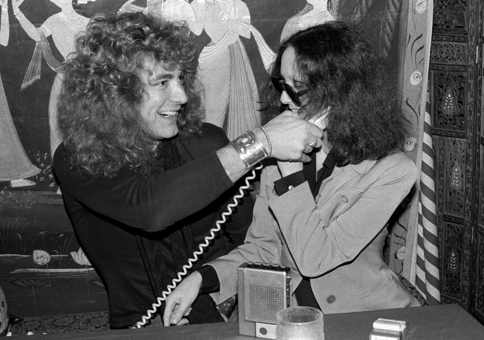 Robinson goofs around with Robert Plant at a New York City restaurant in 1976. (Courtesy of Riverhead Books)
