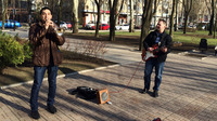 Unfazed by the political turmoil a few blocks away, street musicians in Donetsk play Adele songs on Pushkin Boulevard.