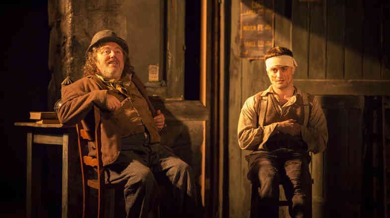 Daniel Radcliffe (right) plays Billy, in a scene with Pat Shortt as Johnnypateenmike, in the Broadway production of Martin McDonagh's The Cripple of Inishmaan.
