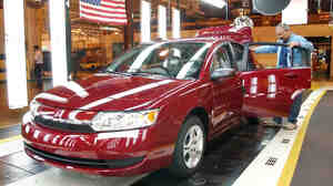 Workers carry out a final inspection of a Saturn Ion at a GM plant in 2004. The model is at the center of a new safety recall over power steering problems.