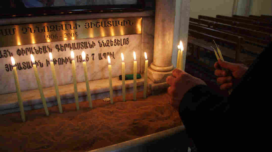 Ahead of Easter Mass, a worshiper lights candles at St. Elie Armenian Catholic Church in downtown Beirut.