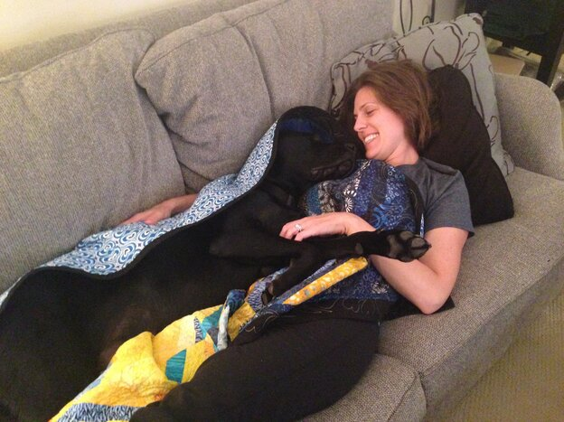 """Jessica Kensky lost a leg in the Boston Marathon bombing. When she says, """"Brr, I'm cold,"""" Rescue the assistance dog knows to bring her the blanket."""