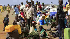 South Sudanese fleeing an attack on the town of Rank, on Saturday. The United Nations says when rebels seized the town of Bentiu, south of Rank, earlier this month, hundreds became victims of ethnically targeted killings.