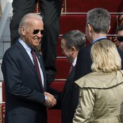 Ukrainian Foreign Minister Andrii Deshchytsia (center) greets Vice President Joe Biden at the airport in Kiev on Monday.