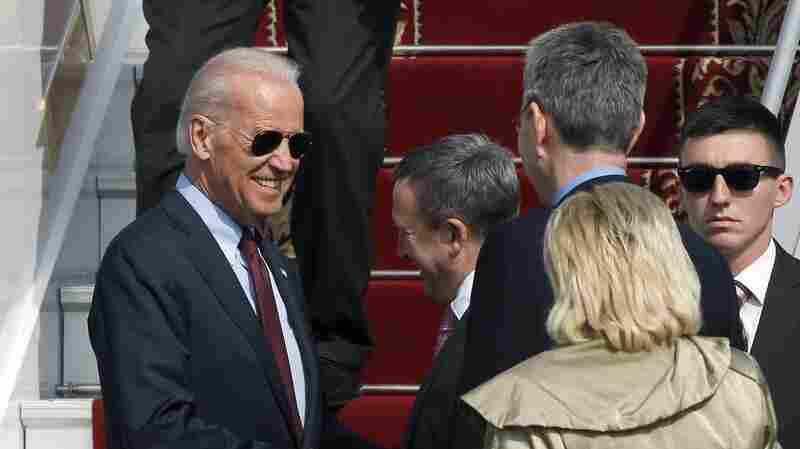 Ukrainian Foreign Minister Andrii Deshchytsia (center) greets Vice President Joe Biden at the airport in Kiev on Monday.