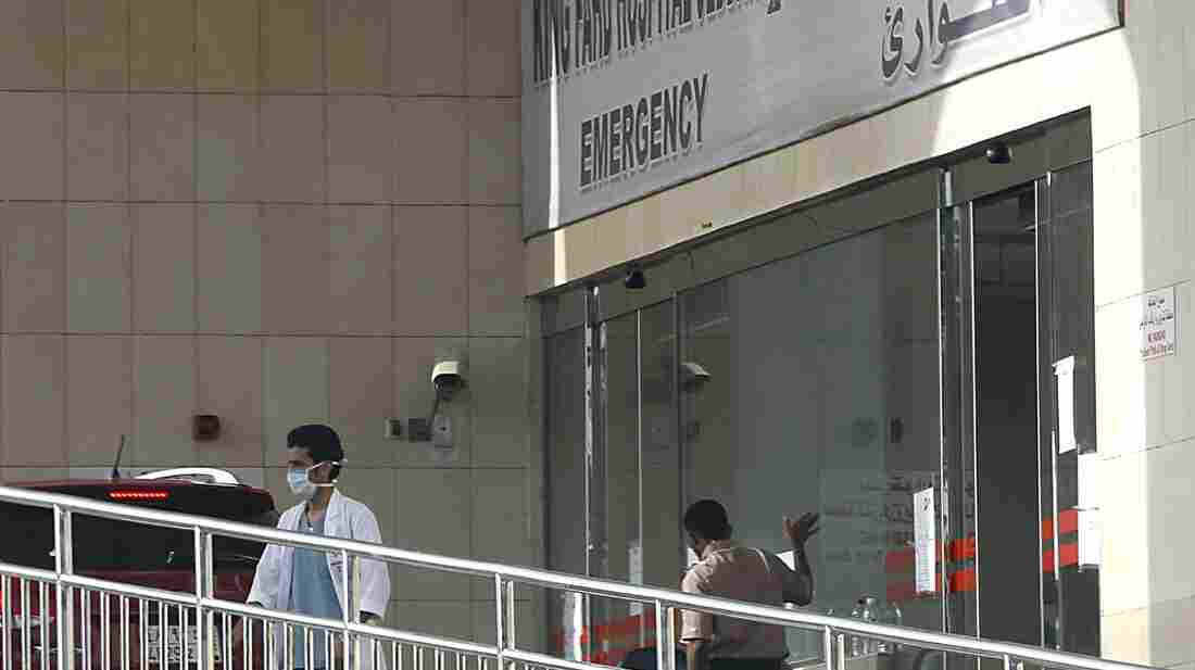 A medical worker stands outside the emergency room of King Fahd Hospital, in Jeddah, Saudi Arabia, April 9. Authorities closed the ER department after two health workers at the hospital caught the Midd