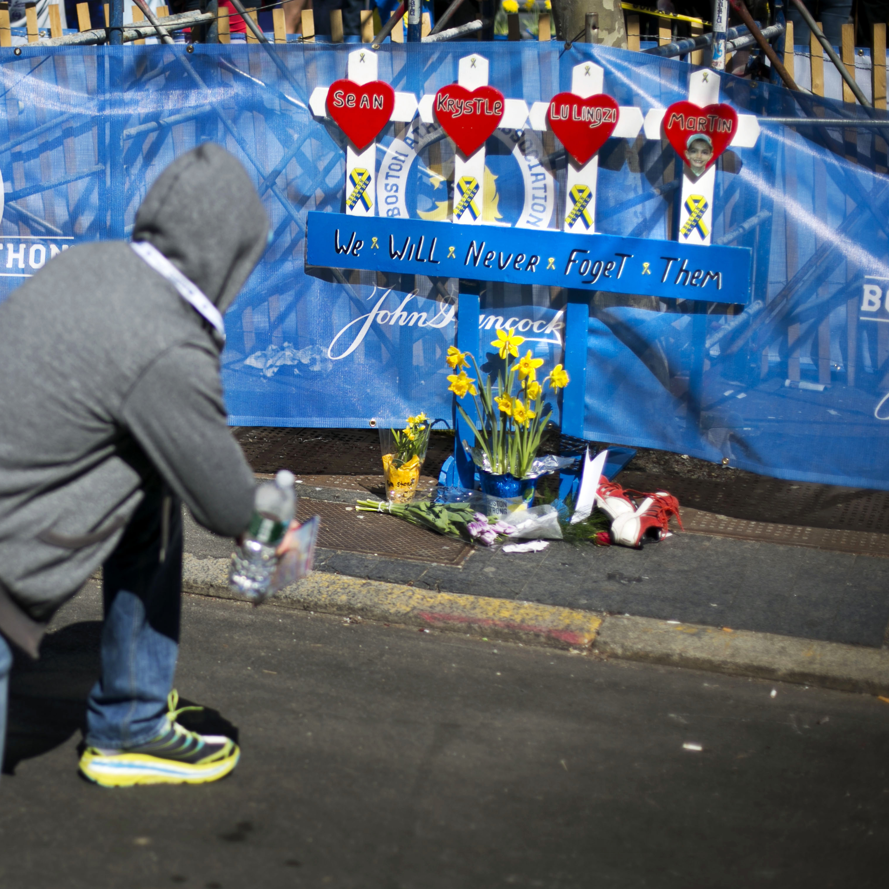 A man pauses at a memorial honoring the victims of the 2013 Boston Marathon bombings on Sunday in Boston.