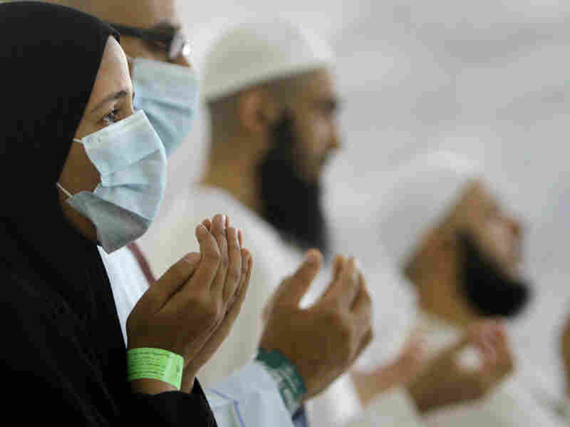 An Egyptian Muslim prays during a ritual in Mina, Saudi Arabia, October 2013. Some people wore masks during the hajj pilgrimage last year to protect against the Middle East Respiratory Syndrome.
