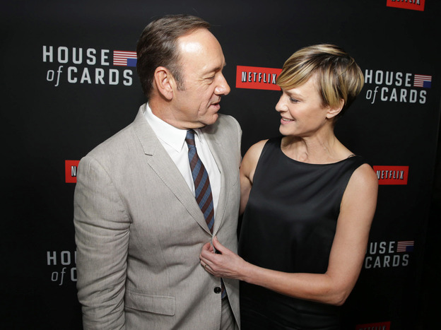 Kevin Spacey and <em>House of Cards</em> co-star Robin Wright at a Netflix special screening of the second season in Los Angeles in February. The original production is seen as a key factor in boosting subscriptions for the video streaming service.