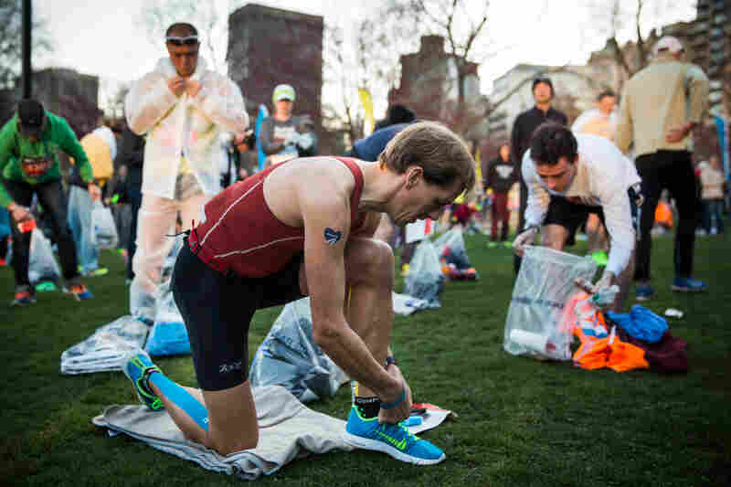 Runners prepare in Boston Common.