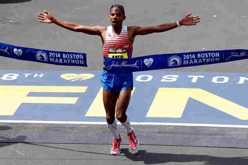 American Meb Keflezighi crosses the finish line to win the 118th Boston Marathon. He was the first American to win the marathon in 31 years.