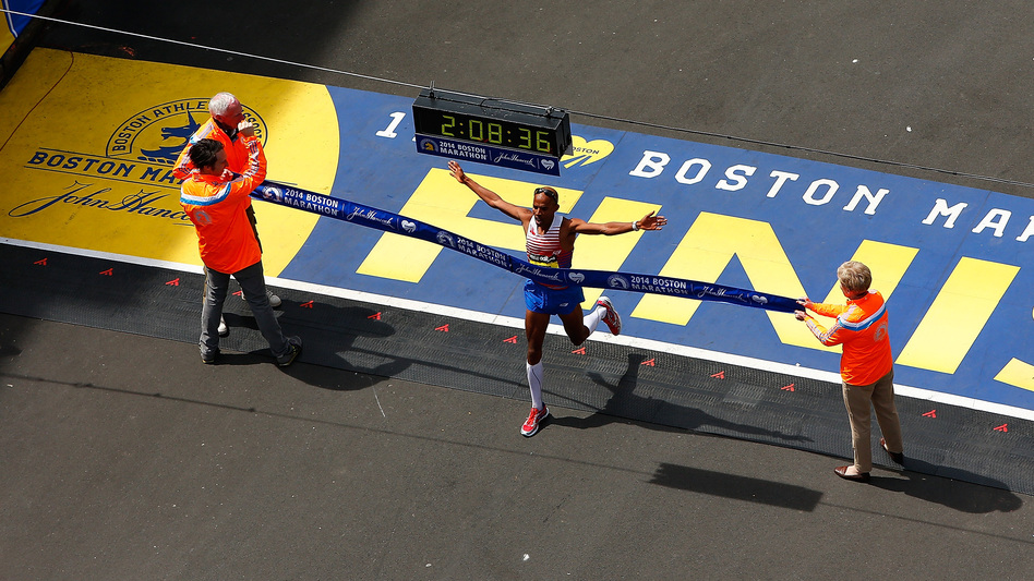 American Meb Keflezighi crosses the finish line in first place to win the 2014 B.A.A. Boston Marathon on Monday. He became the first American man to win the Boston Marathon since 1983. (Jared Wickerham/Getty Images)