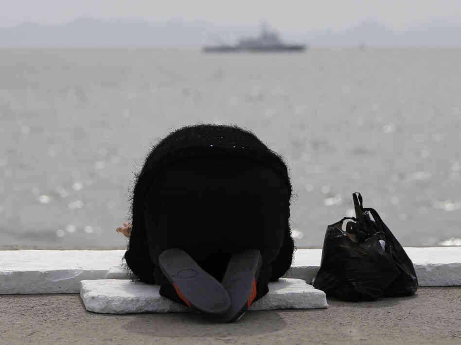 A prayer for the missing and dead: Family members and friends have gathered in the port city of Jindo, South Korea, as the search continues for the scores of passengers still missing after last Wednesday's ferry disaster. At the water's edge, many are offering prayers — including this woman.