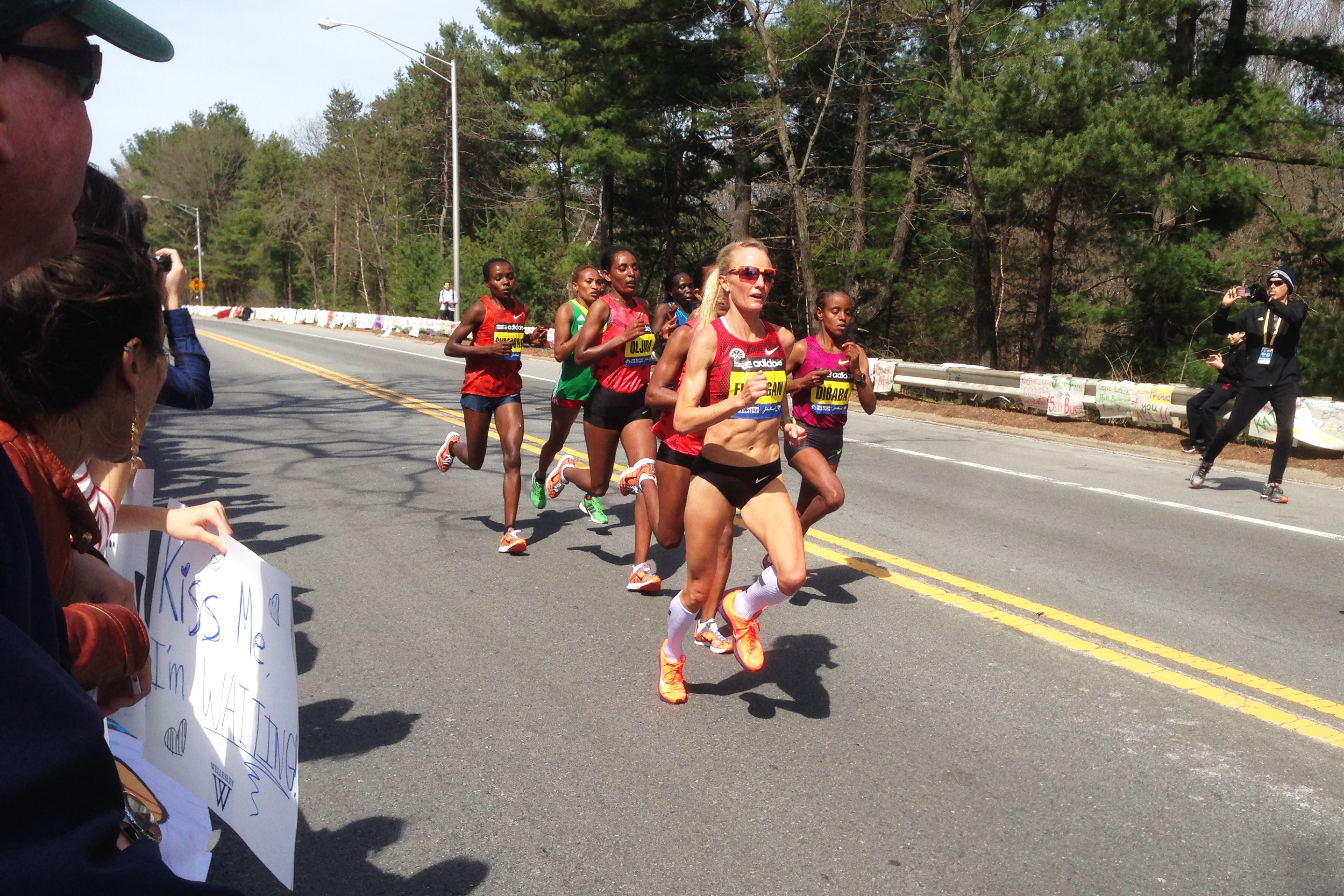 American Shalane Flanagan leads pack of elite women runners past Wellesley College, just before the 13 mile mark.