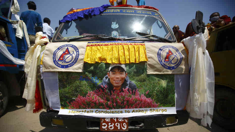 A truck carries the body of Ankaji Sherpa during a funeral rally in Katmandu, Nepal, on Tuesday. Ankaji Sherpa died last week in the avalanche that killed at least 13.