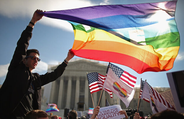 In her new book, Forcing the Spring, investigative reporter Jo Becker goes behind the scenes in the fight for marriage equality. Above, Eric Breese of Rochester, N.Y., joins hundreds of others to rally outside the Supreme Court during oral arguments in a case challenging the Defense of Marriage Act on March 27, 2013.