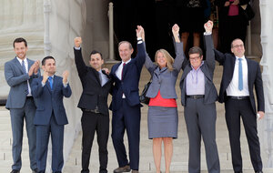 Members of the plaintiff team in the same-sex-marriage cases before the Supreme Court (from left) Adam Umhoefer, executive director of the American Foundation for Equal Rights; plaintiff Paul Katami; plaintiff Jeff Zarillo; attorney David Boies; plaintiff Kris Perry; plaintiff Sandy Stier; and Human Rights Campaign President Chad Griffin wave from the court's steps on June 26, 2013.