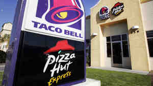 According to a new report, YUM! (owner of KFC, Taco Bell and Pizza Hut) compensated its CEO $22 million in 2013.