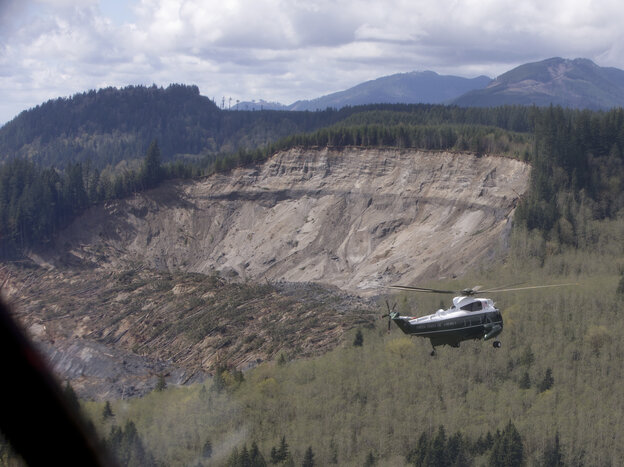 Marine One, carrying President Obama, takes an aerial tour of Oso, Wash., on T