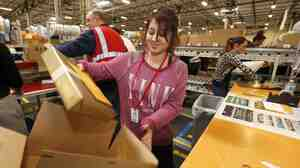 Monica Chavez packs up a box at an Amazon.com fulfillment center Dec. 2, in Phoenix.