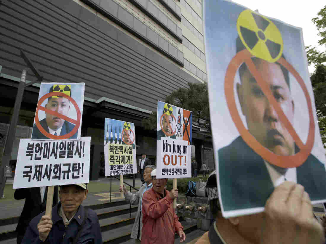 South Korean protesters hold pictures of North Korean leader Kim Jong Un during a rally last week in Seoul. Recent satellite imagery indicates the possibility that Pyongyang is readying for a new nuclear test.