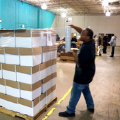 Workers shrink wrap products at the Sertoma Centre located just outside of Chicago.