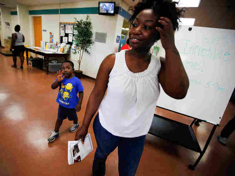 Shartara Wallace picks up her son James, 4, from preschool in Tulsa, Okla.