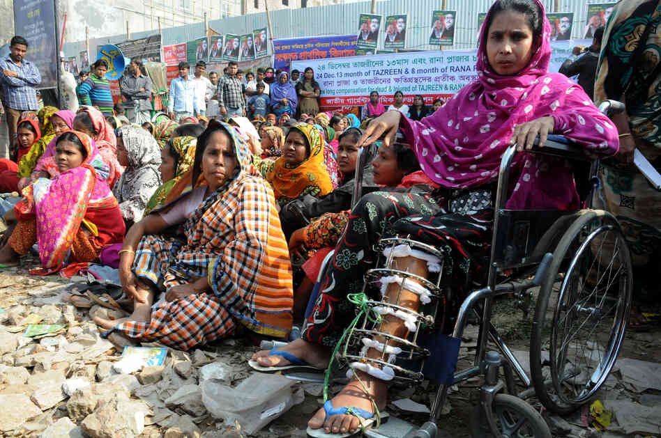 Garment workers and relatives of Rana Plaza victims stage a demonstration on the outskirts of Dhaka, Bangladesh, Dec. 24.