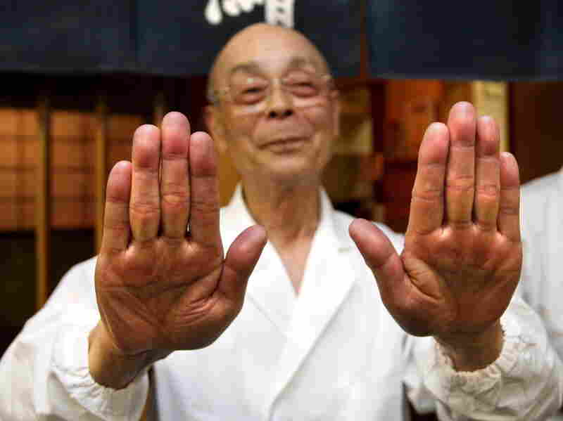 Master sushi chef Jiro Ono shows off his famously soft hands, one of the secrets to his renowned sushi. His restaurant, Sukiyabashi Jiro, is located in the drab basement of an old Tokyo office building.