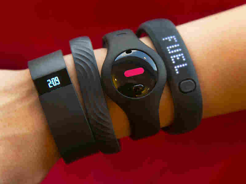 Some forecasters think hearable tech, which you wear in your ear, will outpace the smart watch market. Fitness trackers, from left: Fitbit Force, Jawbone Up, Fitbug Orb and the Nike FuelBand SE.
