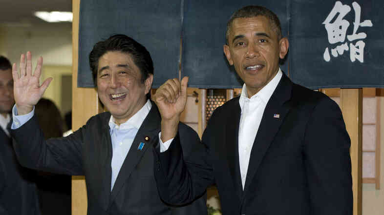 President Obama and Japan's  Prime Minister Shinzo Abe depart Sukiyabashi Jiro