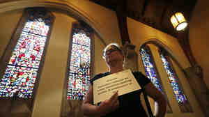 Andrea Teichner protests Georgia's new gun law at a rally at Atlanta's Central Presbyterian Church, on Wednesday.