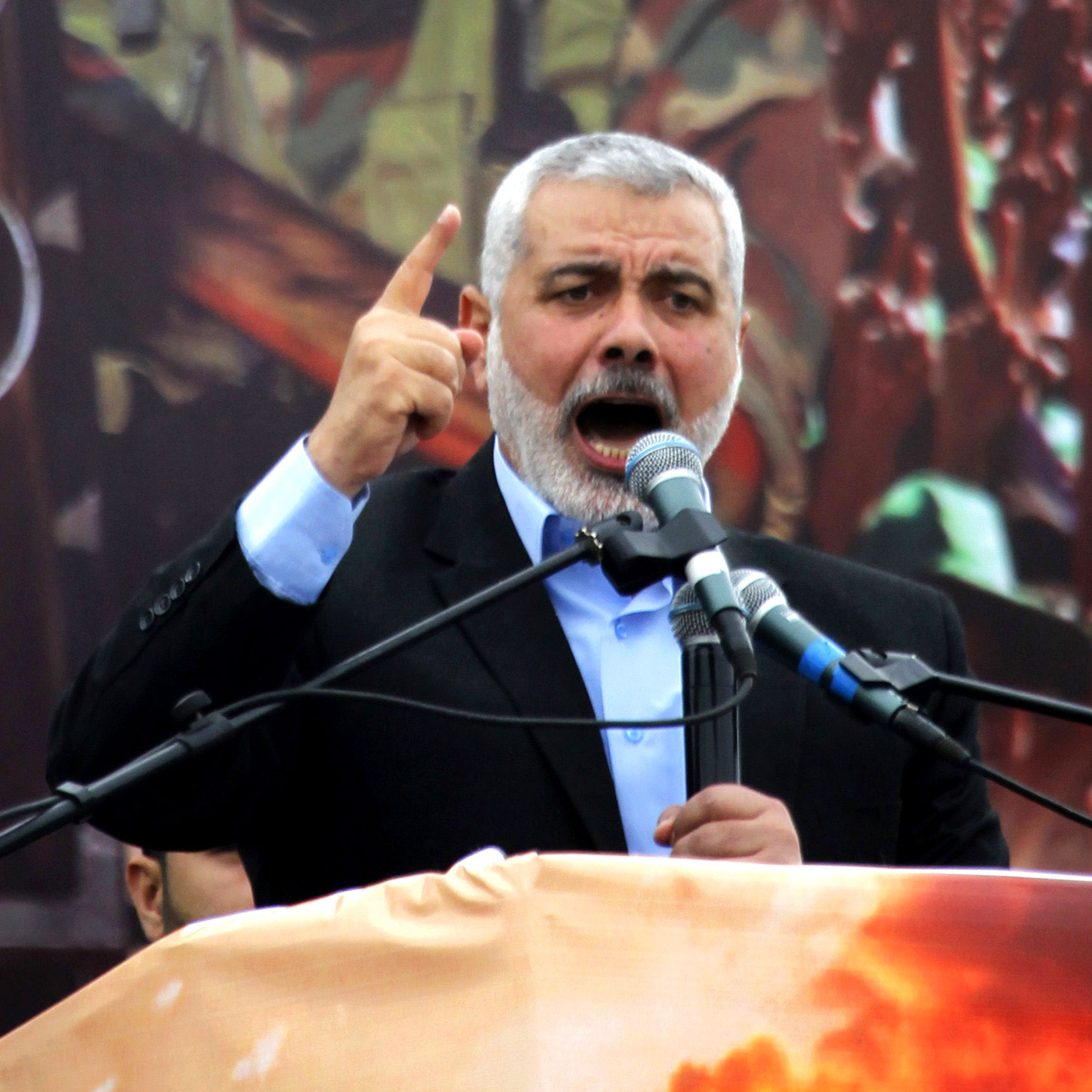 "Hamas leader Ismail Haniya, pictured March 23 in Gaza City, says it's time for the rival Palestinian factions ""to form one government, one political system and one national program."""