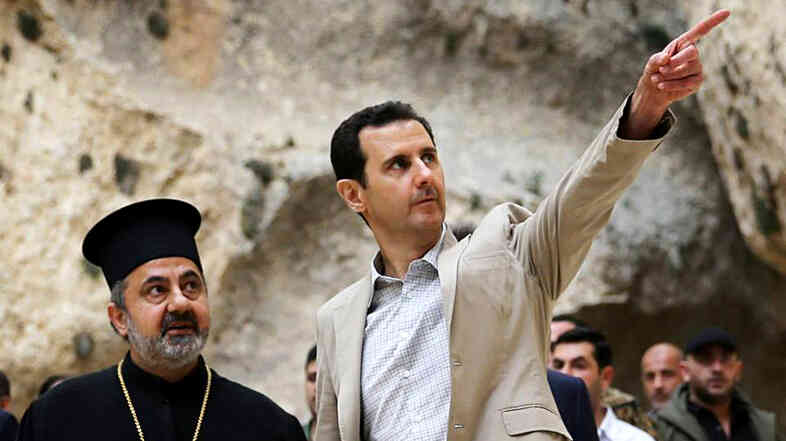 Syrian President Bashar Assad (right) visits the Christian village of Maaloula, near Damascus on Sunday. Assad's forces have been gaining the upper hand in the fighting, and the CIA is now increasing training and aid to Syrian rebels.