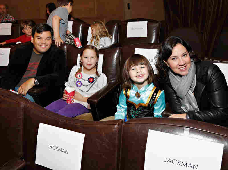 Robert Lopez, Kristen Anderson-Lopez, and their daughters, who appear as singers (and accidental lyricists) in Frozen.