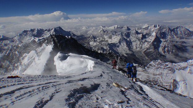 An avalanche last week killed 16 Nepalese guides in the single deadliest incident on Mount Everest. Now, the lucrative climbing industry faces unprecedented turmoil, as expeditions are canceled and Sherpas vow to quit. Here, mountaineers look out from the summit of the world's tallest mountain in May 2013.