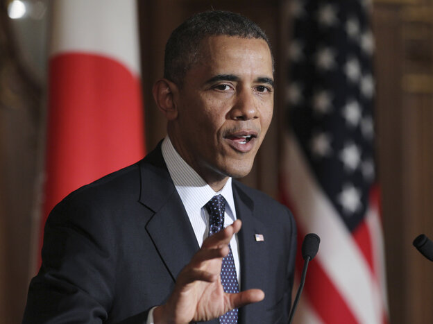 President Obama speaks at a joint news conference with Japan's Prime Minister Shinzo Abe in Tokyo on Thursday. Obama reinforced the U.S.-Japan security commitment.